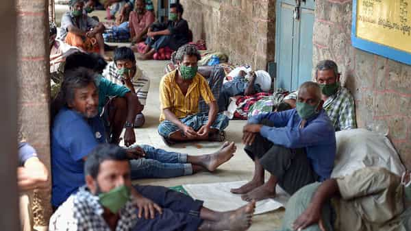 Homeless people take rest at a makeshift shelter, arranged inside a school, during a nationwide lockdown imposed in the wake of coronavirus, in Vijayawada  (ANI)