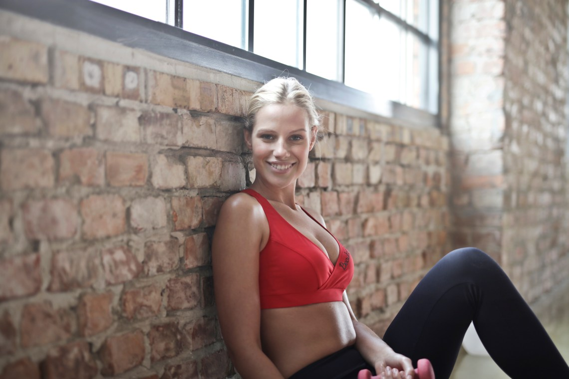 Woman Wearing Red Sports Bra and Black Pants