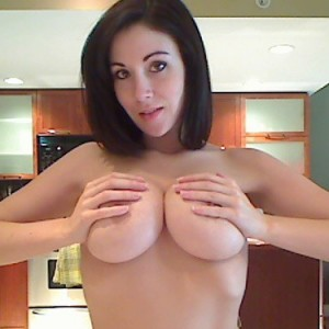 Krissy strips out of her clothes and plays with her huge tits live on cam