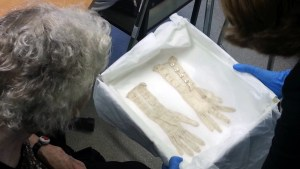 Older woman looks at Lace Gloves