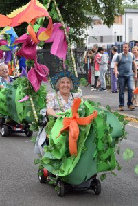 Participant in decorated carnival scooter