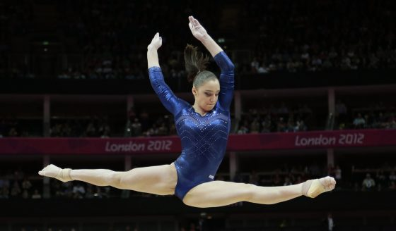 Russian gymnast Aliya Mustafina performs on the balance beam during the artistic gymnastics women's individual all-around competition at the 2012 Summer Olympics, Thursday, Aug. 2, 2012, in London. (AP Photo/Gregory Bull)