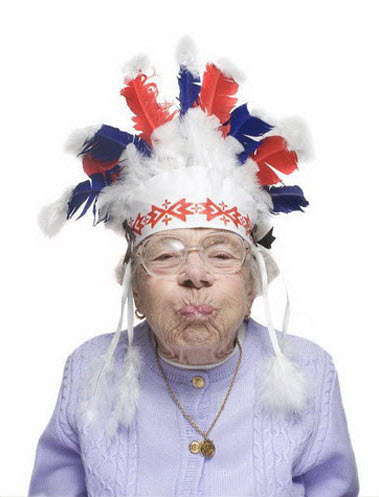 Crazy old lady wearing Native American headdress.
