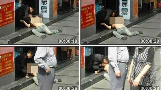 Screen captures of a video showing a drunk man and woman engaging in sexual acts in public in Shanghai.