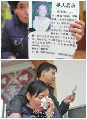 Tang Hui holding up a flier searching for her 11-year-old daughter and in tears.