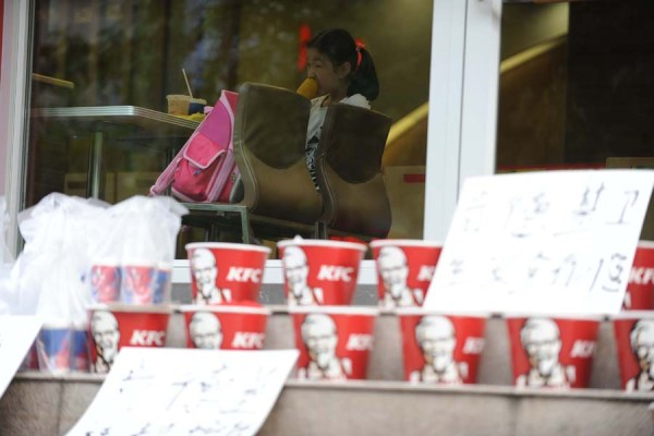 A girl is eating in KFC.