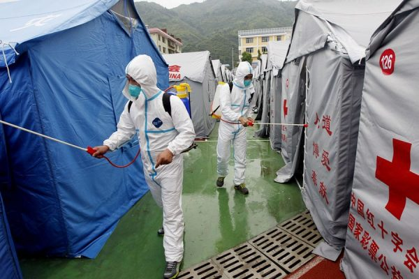 disease prevention staffs are conducting disinfection routine.