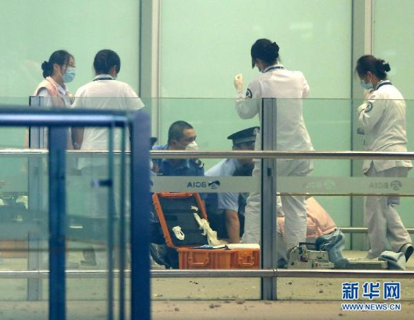 Security and medical personnel respond to explosion at Beijing Airport terminal.