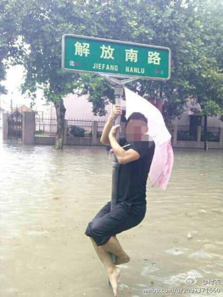 A man jumps in Ningbo downpour.