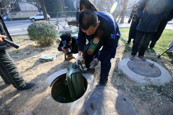"Beijing government officials have  taken ""well"" residents from their homes"