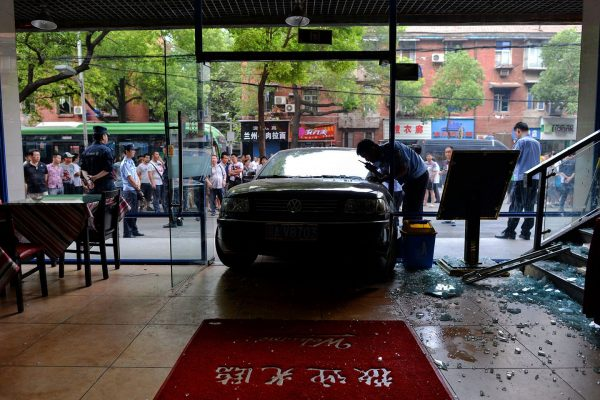 The entrance of the restaurant is crashed by the car.