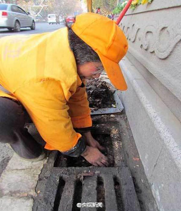 A sanitation worker cleans a sewer