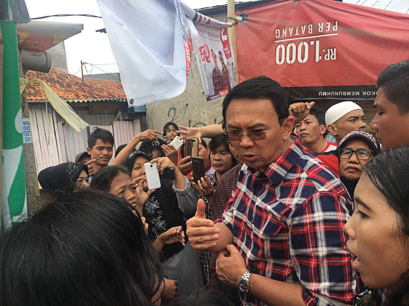 ahok accused of unauthorized campaigning