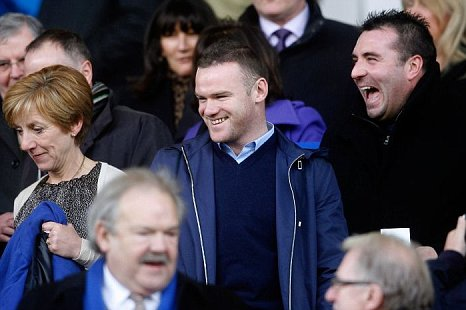 Wayne Rooney watches Everton v Blackpool