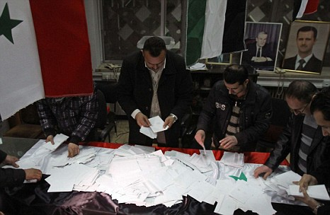 Syrian government workers count ballots