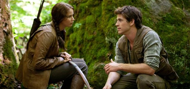 Jennifer Lawrence as Katniss Everdeen and Liam Hemsworth as Gale Hawthorne in The HUnger Games