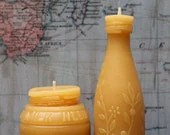 pollenArts Beeswax candles poured into vintage bottle forms – made by nomads in an old Winnebago!