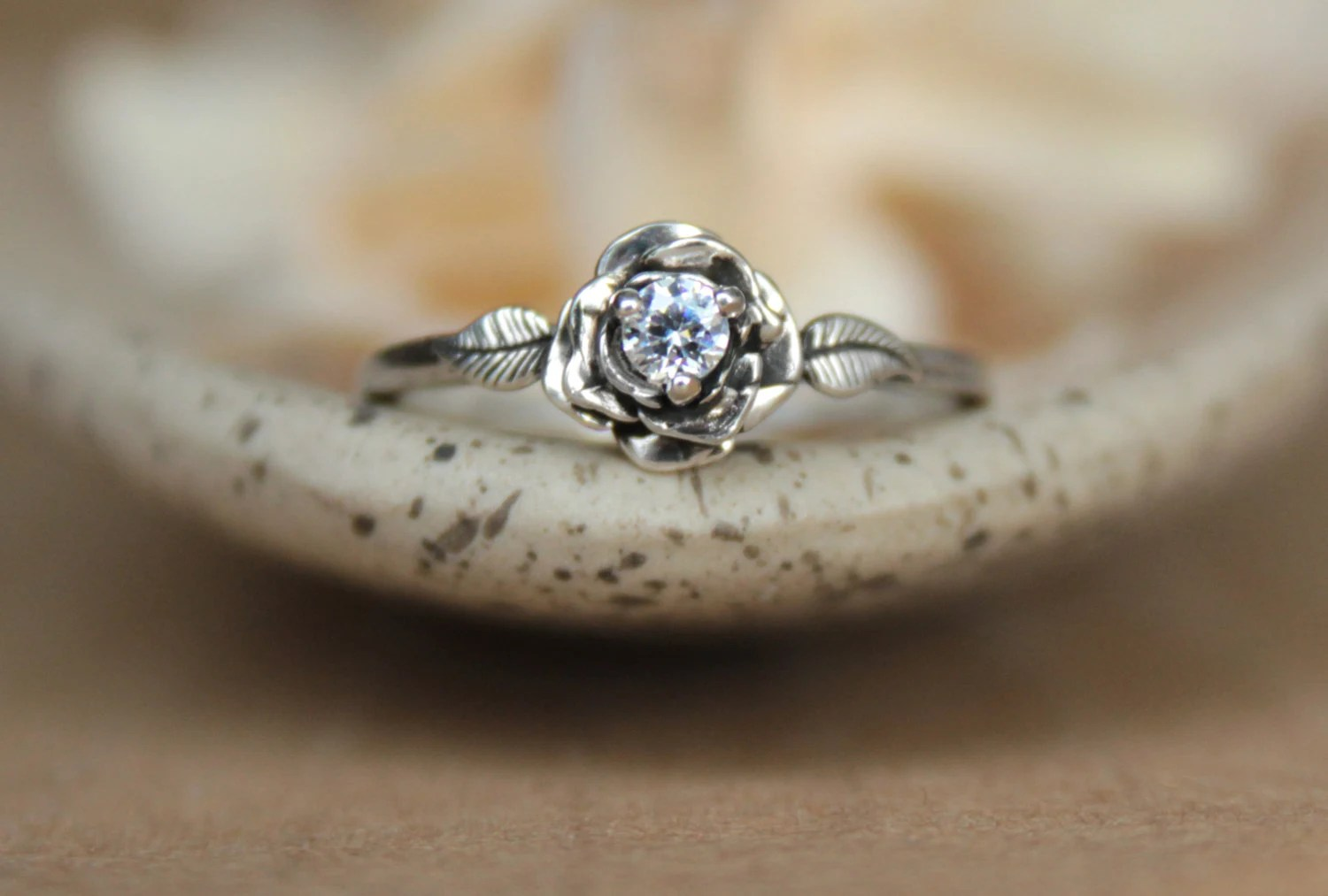 delicate rose engagement ring with white rose wedding ring zoom
