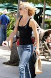 Actress Jenny McCarthy braless in black top shopping at 98% Angel in Malibu