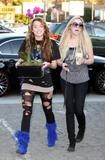 Miley Cyrus goes for a funky style with ripped leggings, gets pedicure, buys orchids in Hollywood - Hot Celebs Home