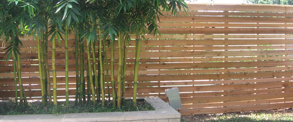 Slat wood fence