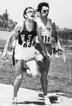 Rick out-leaning Roscoe Divine of Oregon at the Pac-8 track championships.