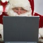 Santa Claus Using Laptop --- Image by © Royalty-Free/Corbis