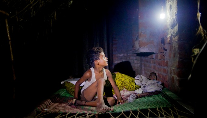 An Indian village home lit up through a micro-grid (Image by Karan Vaid)