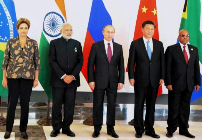 The New Development Bank set up by the five-member BRICS countries - Brazil, Russia, India, China and South Africa - has earmarked its first US$ 811 million batch of loans for renewable energy projects. (Image by Press Trust of India)