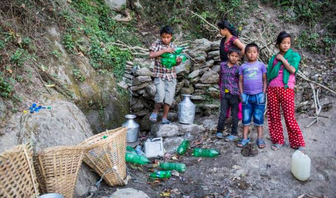 Children walk half an hour to fetch water from a spring during the dry season in Udayapur, south-eastern Nepal (All photos by Nabin Baral)