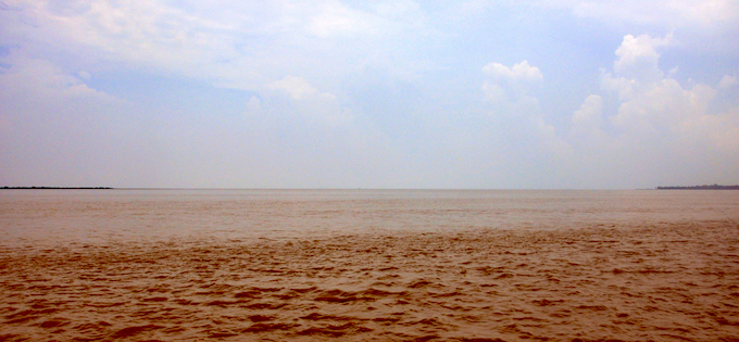 Sagar Island (left) and Ghoramara Island (right) were attached in early 20th century. By the middle of the century, the older people say they could swim across from Ghoramara to Sagar during low tide in a few minutes. Today it takes about 40 minutes to reach Sagar Island from Ghoramara. The gap between the islands has increased mainly due to rapid erosion in Ghoramara.