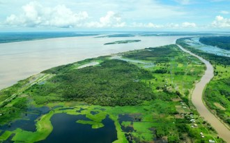 An aerial view of the Amazon river and rainforest in Brazil. (Photo by Neil Palmer)
