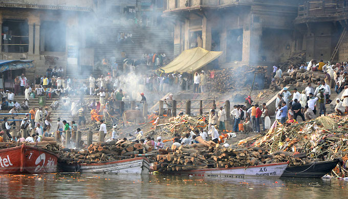 The Manikarnika Ghat cremation ground on the banks of the Ganga River in Varanasi. (Photo by Oliver Laumann)