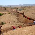 Villagers get together to push desert back