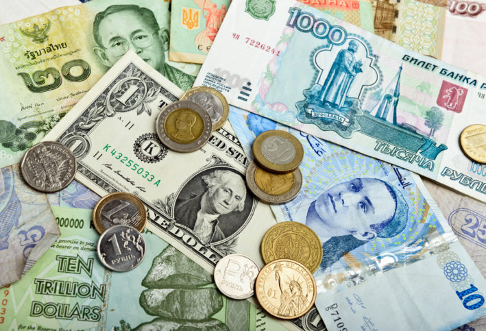 A photo of different kinds of money from around the world.