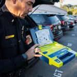 Northeastern Division Acting Captain Charles Lara shows one of the portable defibrillators kept in all their patrol cars. The devices were purchased with funding from the Community Projects, Programs and Services (CPPS) fund. Feb. 2, 2017. Leonardo Castaneda, inewsource