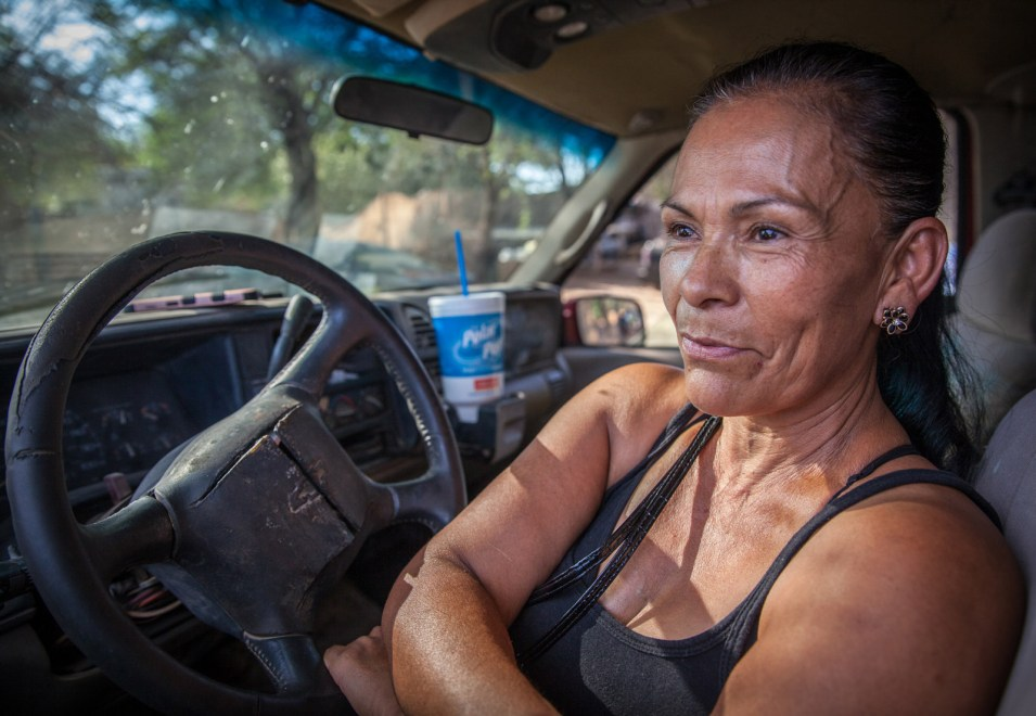 """""""Before, all of this used to be a dump. If there was sewage and potable water, it would be all right,"""" Araceli Silva said. Her sons drilled and installed a well in the backyard of her home in Wall Lane, Ariz. (Maria Esquinca/News21)"""