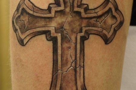 cross tattoo idea on arm