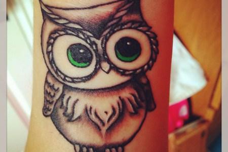 green eyed owl tattoo