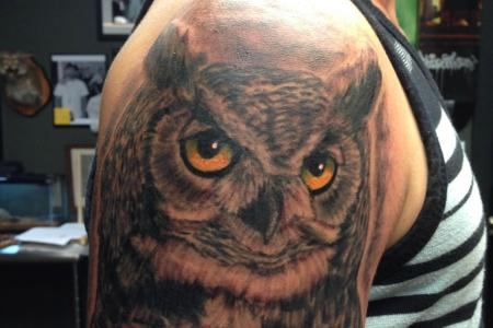 very realistic tattoo of owl