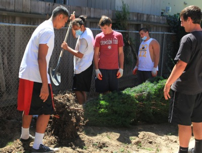 M-A football team at community service work day
