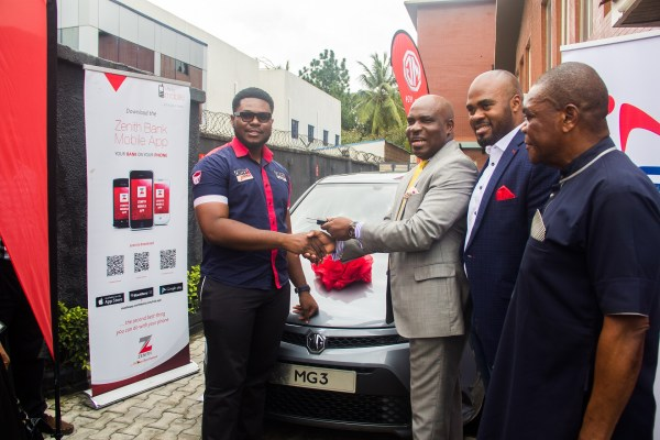 CHISCO's Executive Director Obinna Anyaegbu collecting the star Prize key from Coscharis Motors General Marketing Manager Mr Abiona Babarinde