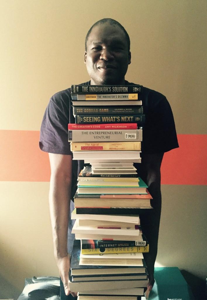 Brian & His Books (Image Credit: Tasha S. K. Aoaeh)