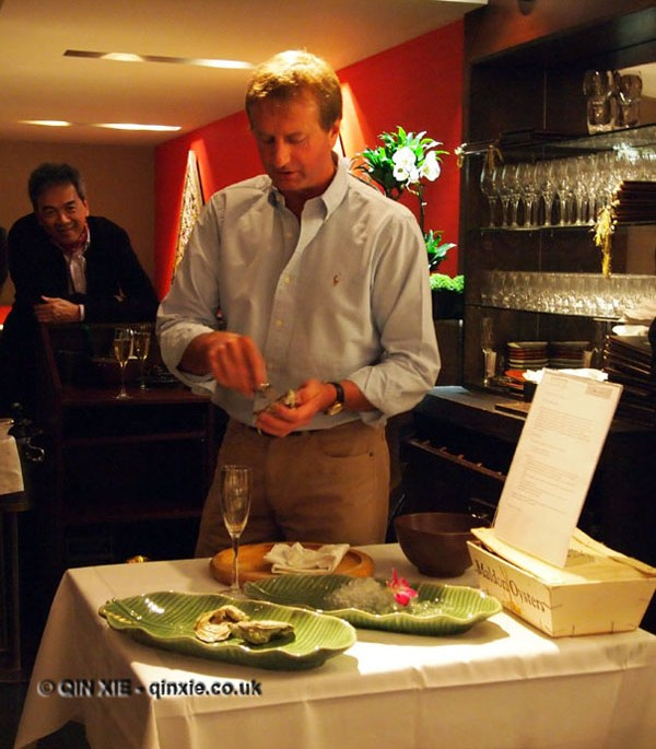 Richard Emans demonstrating oyster shucking at Patara, Greek Street