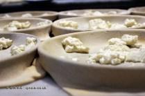Focaccia with cheese in the making, Restaurante i Tre Merli Porto Antico, Genoa