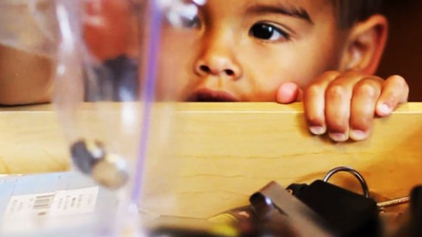 This frame grab provided Sept. 13, 2011, by Energizer/Safe Kids USA shows a youngster holding a bag of small button batteries. / AP