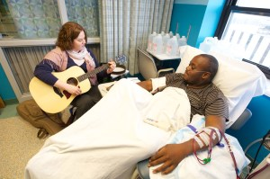 Music therapist Sarah Tobias and dialysis patient Chris Blackwell jam together