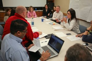 A team of pediatric specialists meet with Megan and Mark to discuss a plan of care for their baby.