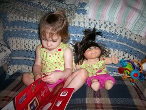 Bekah practices reading to her new brother or sister.