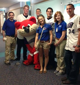 Michelle Cooley (second from right) with Akron Aeros players, staff and Orbit.